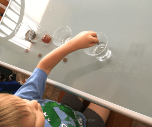 Try this simple and fun science experiment with your kids! Challenge them to clean a penny with ketchup and other kitchen condiments. Does it work? Learn the science behind this neat chemical reaction! #science #STEM #learning #activity #kids Team-Cartwright.com