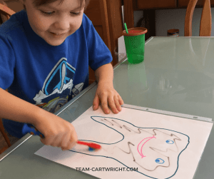 Tooth brushing activity in action! Learn how to help your child brush their teeth, plus get a free printable! #toothbrushing #brushteeth #preschool #toddler Team-Cartwright.com