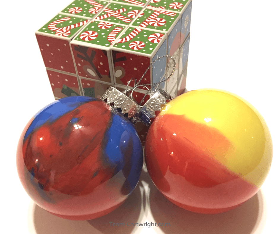 Homemade Marbled Ornaments: A Fun STEM Christmas Activity. Make some fast and fun Christmas ornaments and learn a little science! Easy, fun, and full of holiday joy. #christmasscience #christmasSTEM #science #STEM #homemadeornaments #christmascraft #learningactivity #christmaslearning #toddler #preschool #kids Team-Cartwright.com