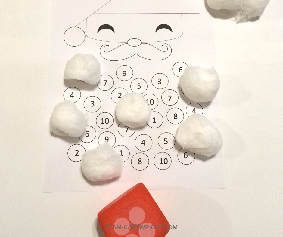 Christmas STEM! Work on number sense, counting, and math with this fun printable Santa game. Easy holiday STEAM! #christmaslearning #christmasSTEM #mathgame #freeprintable #learningactivity #preschool #toddler #numbersense #counting Team-Cartwright.com