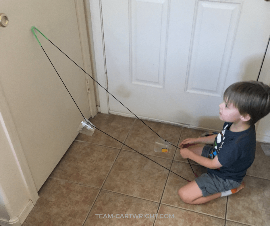 How to make a funicular train at home! (Also known as a ski lift. :) ) Learn how to utilize pulleys to create this fun lift, and teach your child some physics! #FunicularTrain #SkiLift #SimpleMachines #PulleysForKids #STEM #Physics Team-Cartwright.com