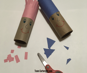 Create an adorable hair cut salon! Toilet paper tubes and construction paper make a fun at home craft that also works cutting skills. #ScissorSkills #CuttingPractice #PreschoolCraft Team-Cartwright.com