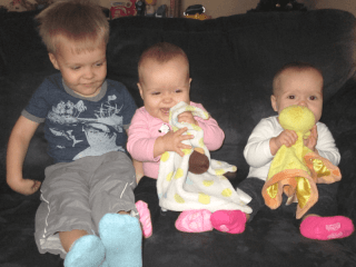 picture of a toddler and twin babies