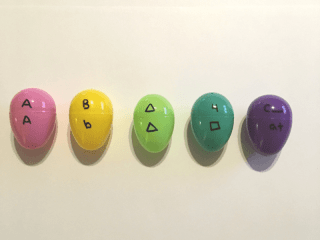picture of easter eggs with matching letters, shapes, and numbers for toddler learning