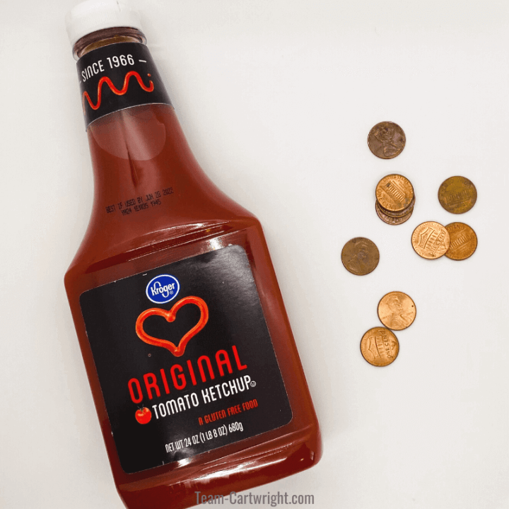 picture of bottle of ketchup with pennies for cleaning pennies with ketchup science experiment for kids