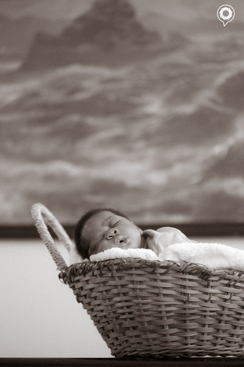 child asleep in basket