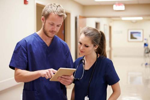 healthcare medical staff consult with their team using a tablet