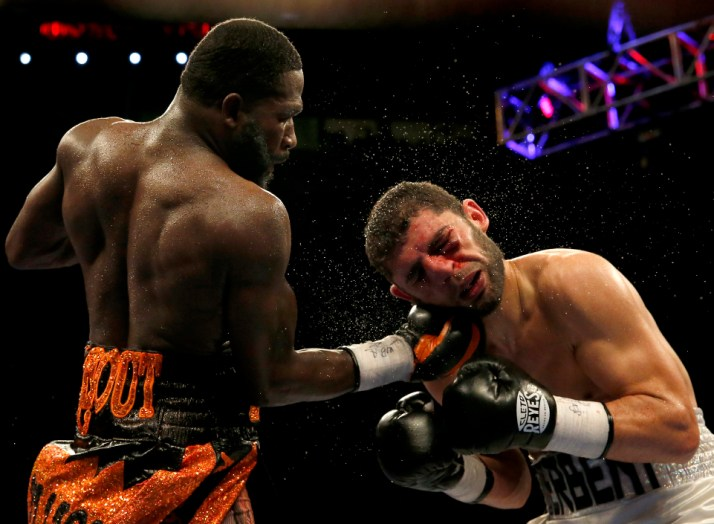 Adrien Broner, of Cincinnati, left, lands an uppercut punch against Khabib Allakhveriev during the 12-round WBA super lightweight bout, Saturday, Oct. 3, 2015, at US Bank Arena in Cincinnati, Ohio.