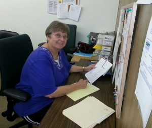 Nancy Wolff working at her desk at the TEAM Pantry.