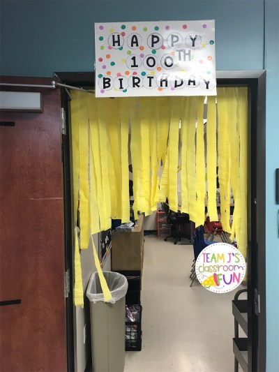 Happy 100th Birthday sign with streamers in doorway.