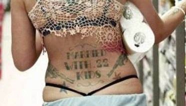 Woman with 22 Kids Pistols tramp stamp Worst tattoos bad tattoos funny stupid crazy horrible regrettable wtf awkward family photos