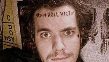 Rock-n-Roll Victim on Forehead Bad Tattoos Worst Tattoos Funny Regrettable WTF Horrible Tattoos Terrible Stupid People Awkward Family Photos Nasty Regrets