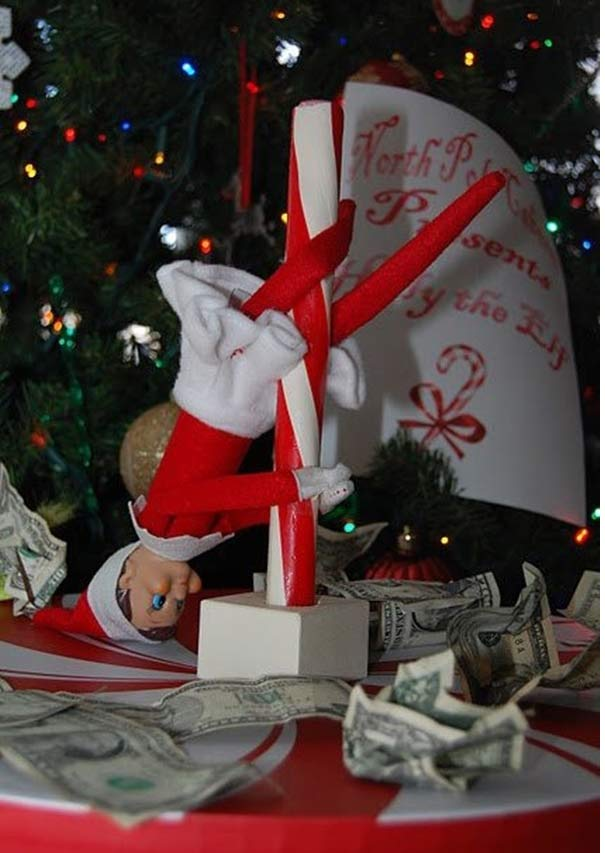 Inappropriate Elf pole dancing on candy cane