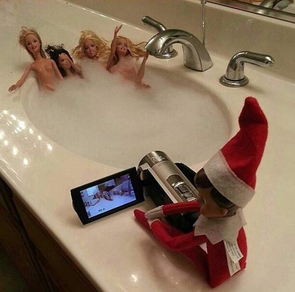 Inappropriate Shelf Elf videoing Barbies in sink hot tub