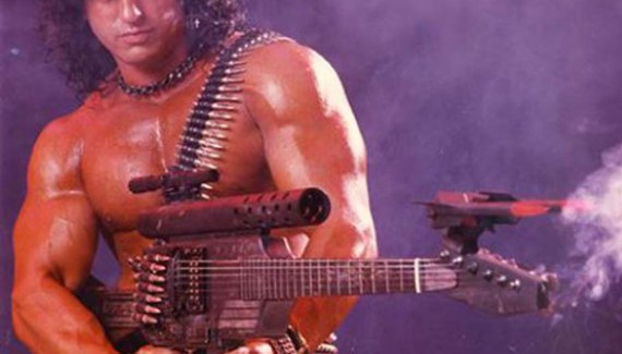 Rambo parody, 1980s dude, big hair, with machine gun guitar