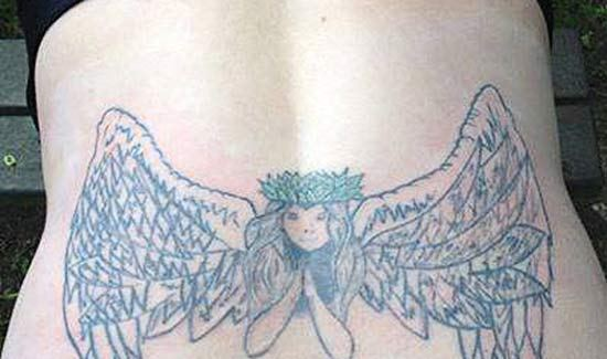 winged angel tramp stamp ~ Worst Bad Tattoos