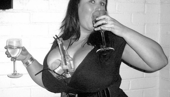 Funny Awkward Family Photos: Big Boobed woman drinking double fisted with drinks between her breasts