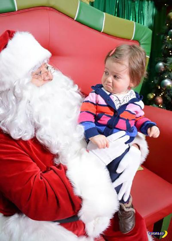 41 Funny Christmas Photos ~ Skeptical baby on Santa's lap