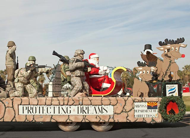 41 Funny Christmas Photos ~ Military parade float with Santa and reindeer protecting dreams