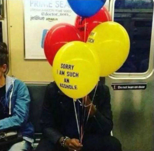 33 Funny Pics of Random Offbeat Weirdness ~ man on subway with sorry I'm such an asshole balloons