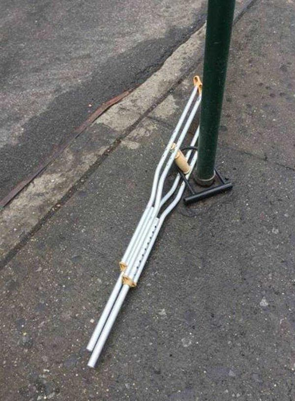 Crutches locked to lampost with bike lock
