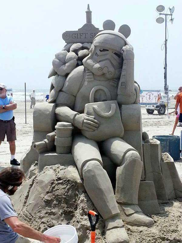 Great sand sculptor ~ shopping stormtrooper sitting in chair holding wife's purse