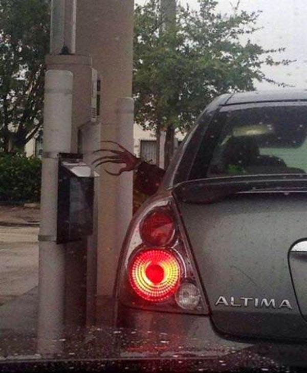 Woman with creepy long nails at bank drive thru