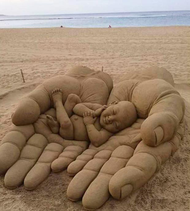 Incredible ~ amazing sand sculpture baby sleeping in hands ~ 33 funny pics and memes