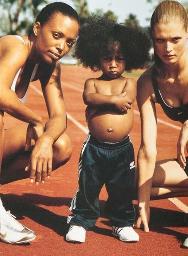 Funny portrait, track runners kid with attitude