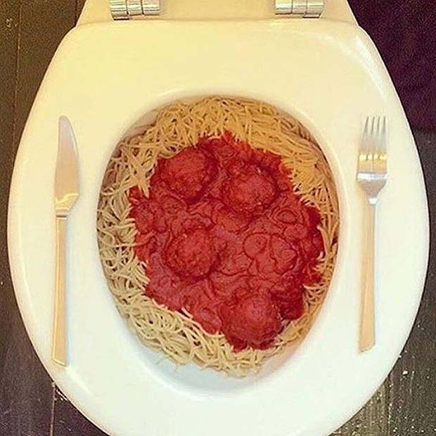 Pasta! weird pic of spaghetti and meatballs in toilet table setting