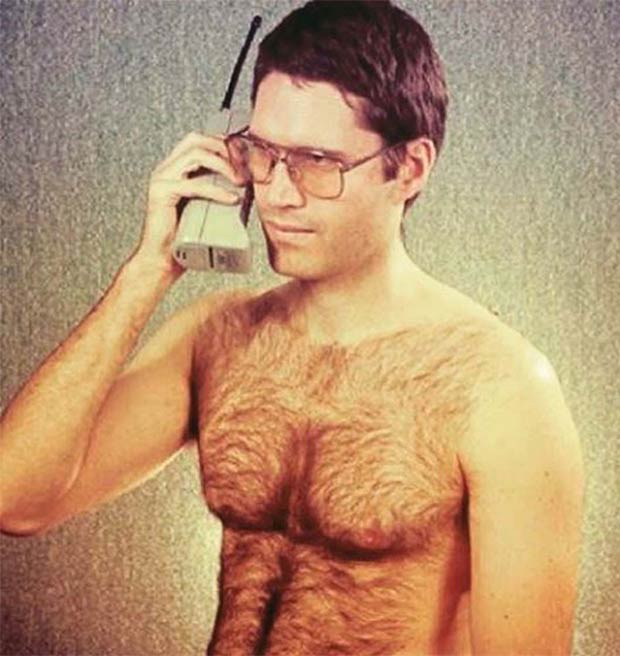 Vintage ad ~ early 1980s cell phone with bare chested mad vintage