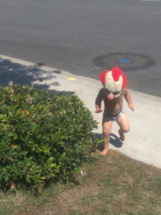 Creepy old snap of little kid in clown mask ~ Funny Pics & Memes