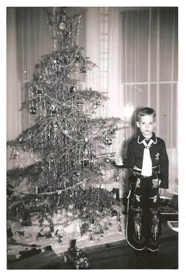 Oh, someone's not a happy cowboy! ~ Funny Family Christmas Photos ~ old vintage Christmas pics, boy in cowboy outfit