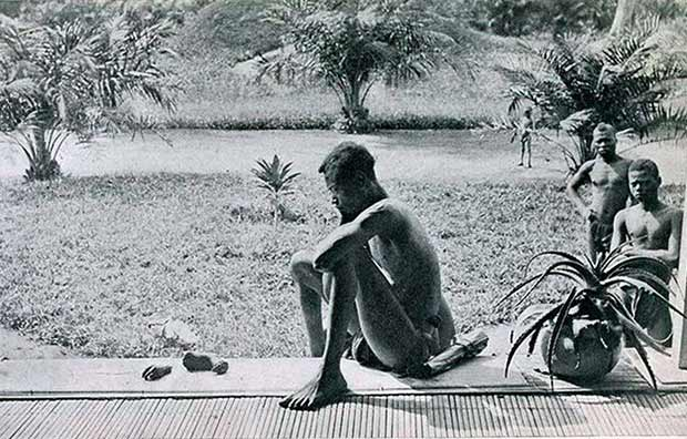 A Congolese man stares at the severed hand and foot of his five-year-old daughter who was killedand, allegedly,cannibalized, by the members of the Anglo-Belgian India Rubber Company militia in 1904. The sickening act was carried out as punishment on the father who had failed to make the daily rubber quota.