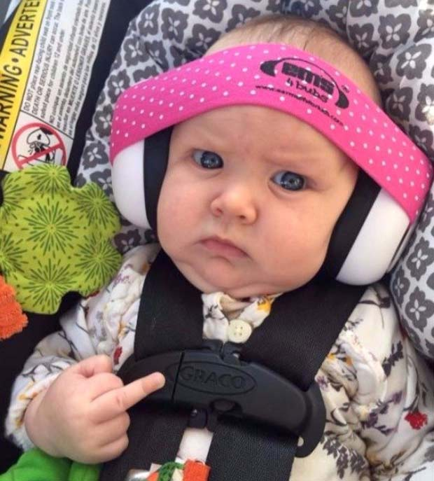 Rock on... baby in headphone flipping the bird ~ funny pics and memes finger