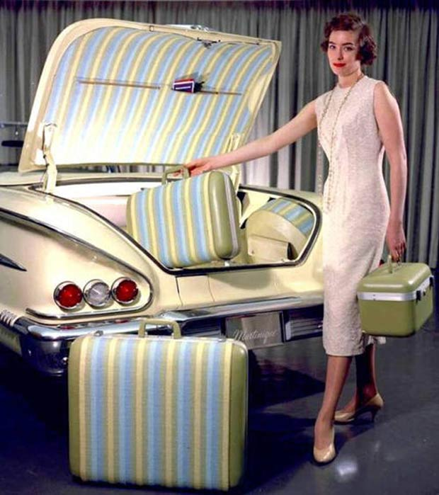 Vintage auto show model, matching luggage, vintage ad