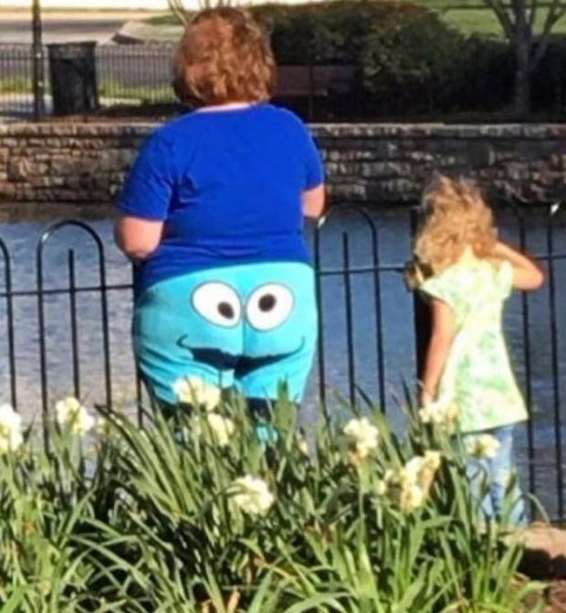 woman with google eyes on butt shorts