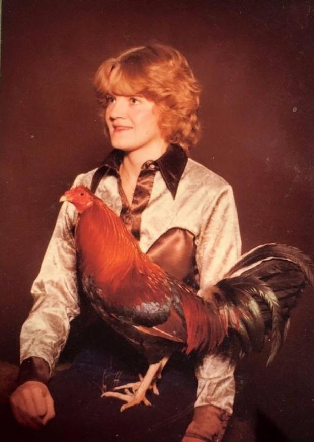 31 Funny Awkward Family Photos ~ vintage portrait girl holding chicken
