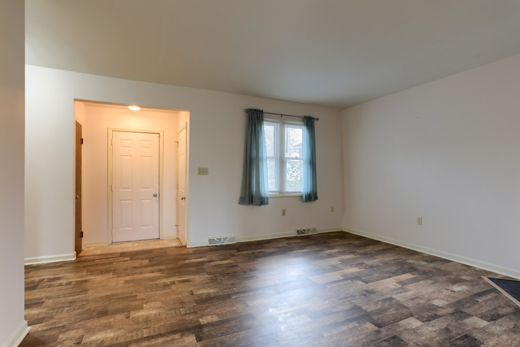 2158 Walnut Street - Living room and foyer with access to garage and coat closet