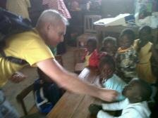 Fred giving deworming medication to the children.