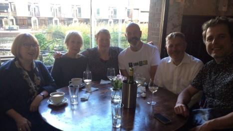 A table of new friends. Rebecca, Mona, Vivian, Alan, Tim, David.