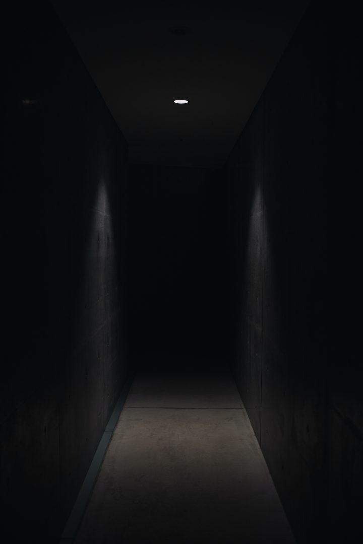 dark pathway lit with small light fixture
