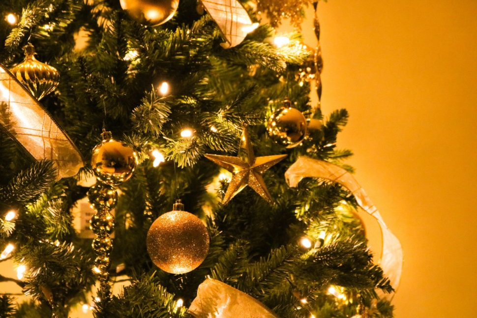 green Christmas tree with gold decorations