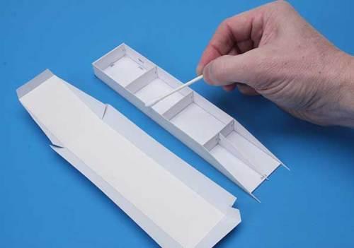 Applying glue with a cotton swab