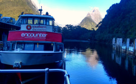Milford Sound Small Boat Cruise Red in dock