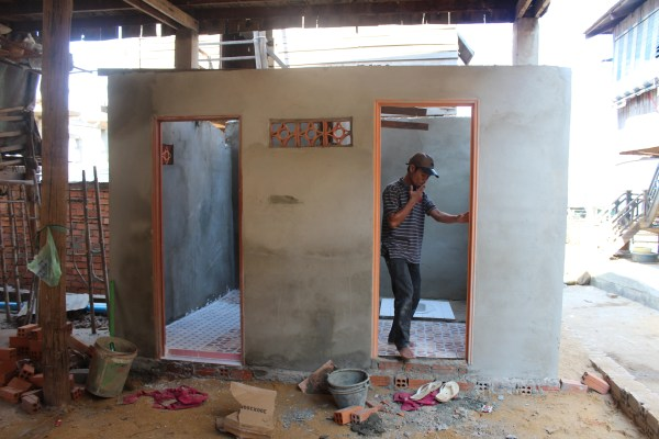 The toilet in village 2 was being built and it was nearly finished.