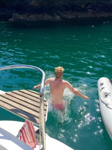 Causing a splash when jumping from boat to sea.