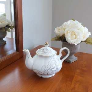 British style white ceramic teapot