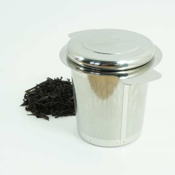 steel infuser with cap on and with loose Ceylon black leaf teacap on