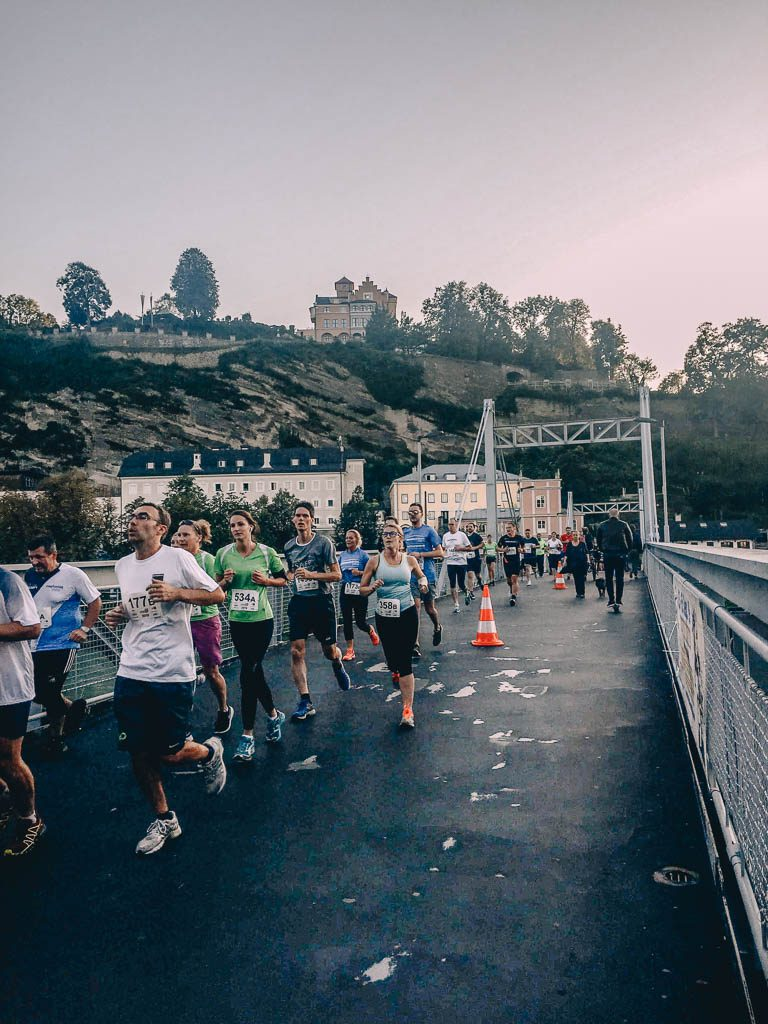 views over the Salzach River with runners